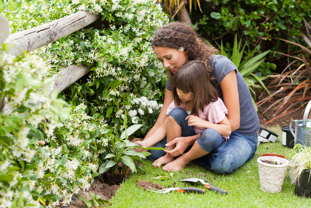 Mother and daughter working in the garden-1